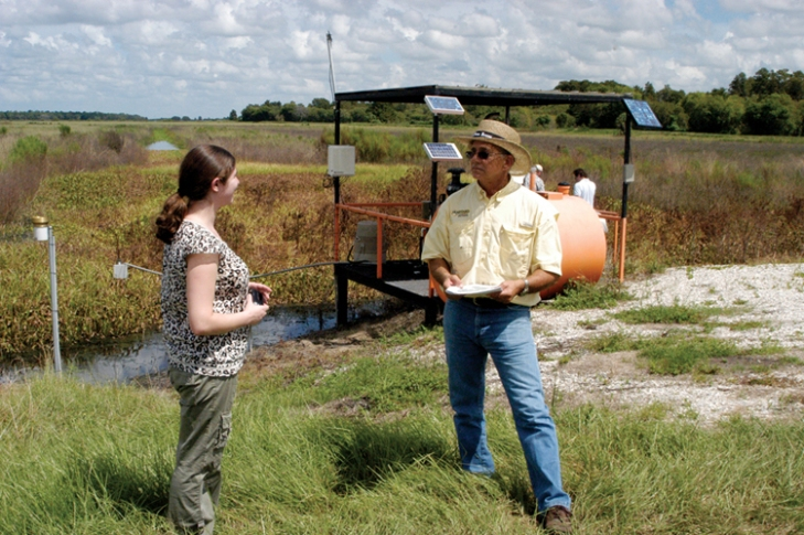 Jane Graham, the Everglades policy associate at Audubon Florida, and Jimmy Wohl at a pumping station on Wohl's Rafter T Ranch.
