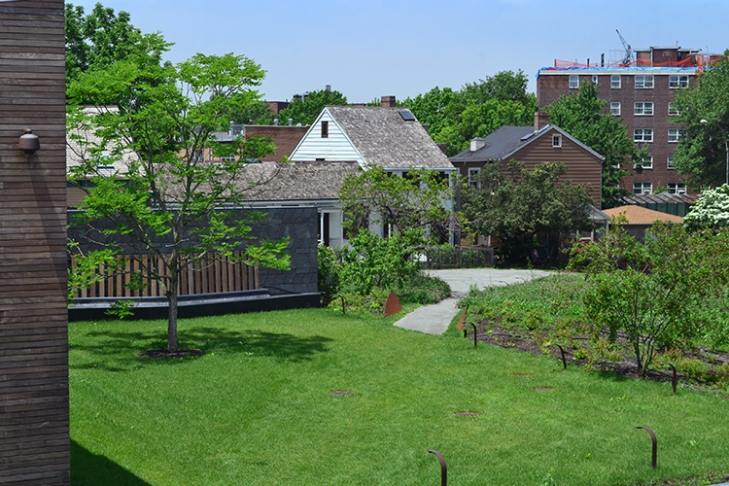 Now viewed across the lawn and meadow, the houses evoke the settlement's rural character.