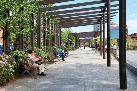 The pergola in North End Parks creates a structured edge to the greenway.