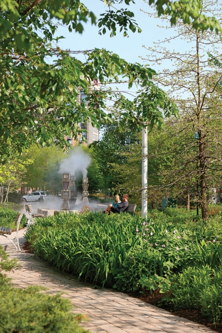 Artist Ross Miller's Harbor Fog—an interactive work featuring lights, mist, and sound—is one of the temporary public art installations acquired by the greenway.