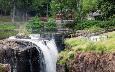The visitors on the footbridge have a dramatic view of the Great Falls near Mary Ellen Kramer Park.